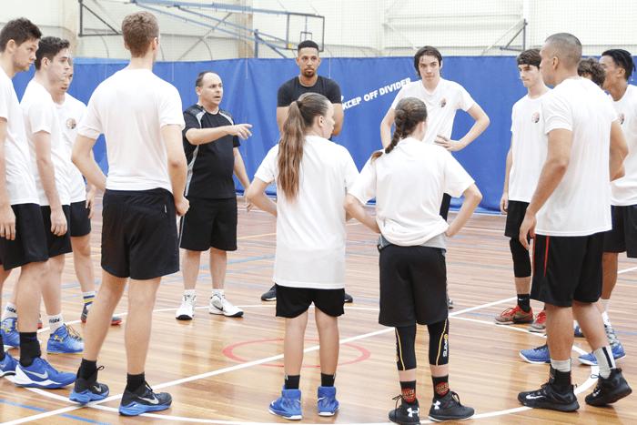 Ozswoosh Academy basketball huddle