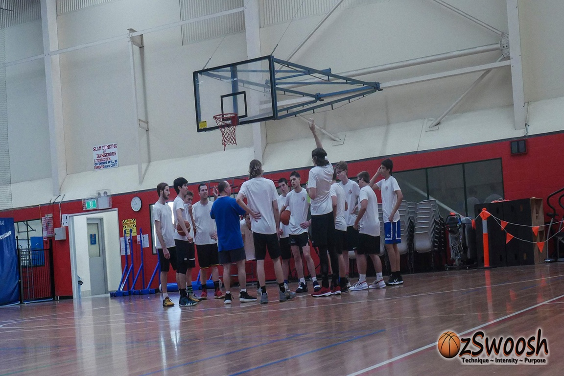 OzSwoosh Head Coach Craig Rowe in a huddle with his OzSwoosh Academy athletes.