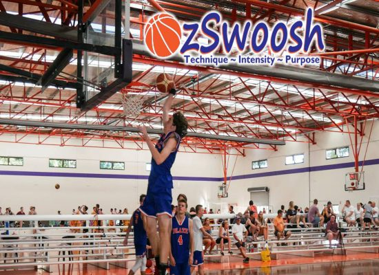 OzSwoosh Basketball Academy athlete Aaron Baigrie (16 years) dunks in warm up at the Oz Day Carnival in 2018