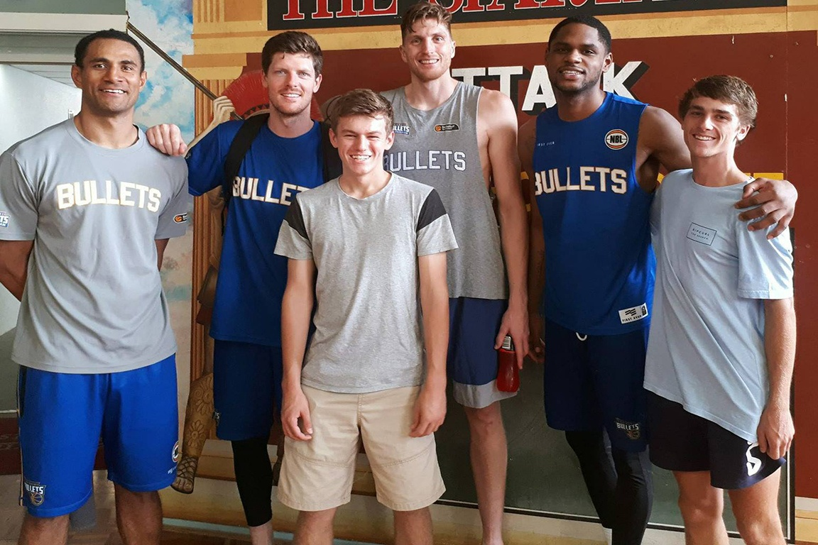 Coach Craig Rowe surprised two of his OzSwoosh Academy athletes with a surprise visit to watch the Brisbane Bullets train and to meet some of the players.